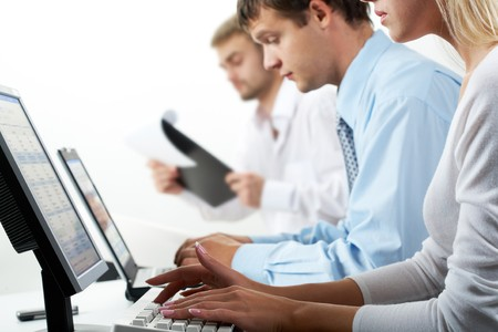 desktop computers: Image of female typing on keyboard in working environment   Stock Photo