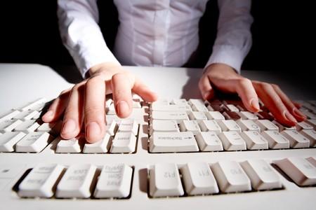 Image of human hands pressing keys on keyboard Stock Photo - 8228978