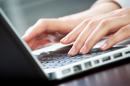 Image of human hands pressing keys of laptop Stock Photo - 8228953