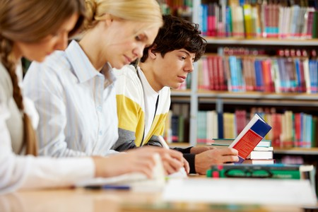 Portrait of serious groupmates preparing lessons in college library Stock Photo - 8229009