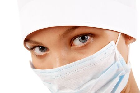 Face of nurse in sterile mask looking at camera over white background Stock Photo - 8229246