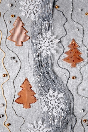 bedeck: Different christmas decoration over silver background