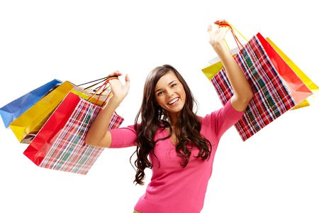 Portrait of happy girl with colorful paper bags looking at camera and smiling Stock Photo - 8229437