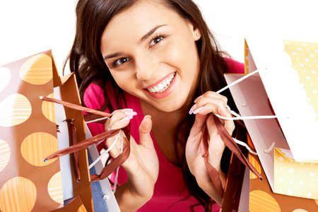 Portrait of happy girl with colorful paper bags looking at camera with smile  Stock Photo - 8229372