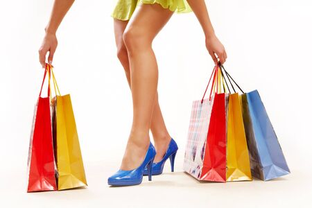Legs of lady standing and holding colorful paper bags Stock Photo - 8229315