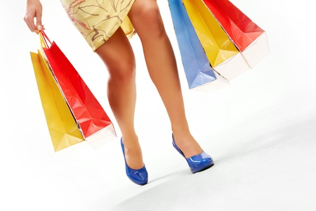 Legs of lady with colorful paper bags in move Stock Photo - 8229320