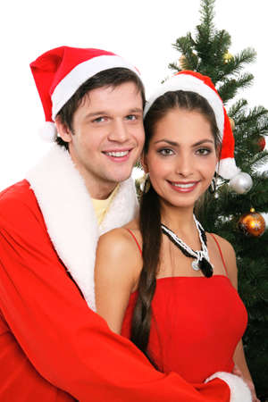 Portrait of young couple in red santa claus hats  photo