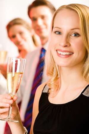 Portrait of attractive woman with smile on the background of her friends  Stock Photo - 8313289