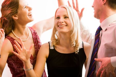 Portrait of three people funning and dancing Stock Photo - 8313347