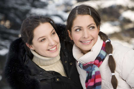 Two smiling girls having fun in the winter forest Stock Photo - 8312688