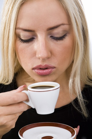 Portrait of pretty woman drinking coffee photo