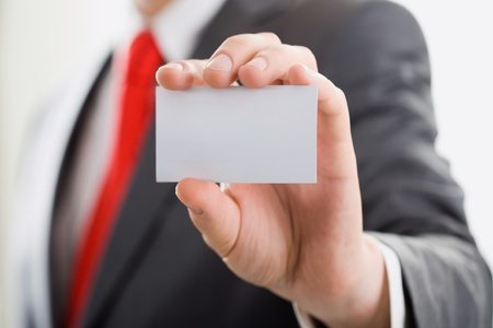 A businessman is showing his calling card photo