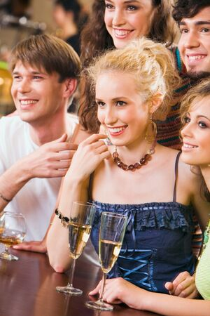 Wonderful picture: happy people looking at a barman Stock Photo - 8313150