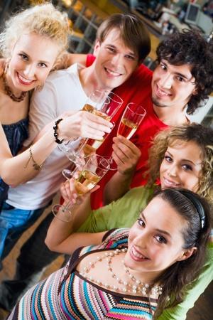 Friends at a celebration enjoying a champagne photo