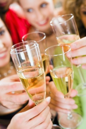 Close-up of a wineglasses in a celebration clink photo