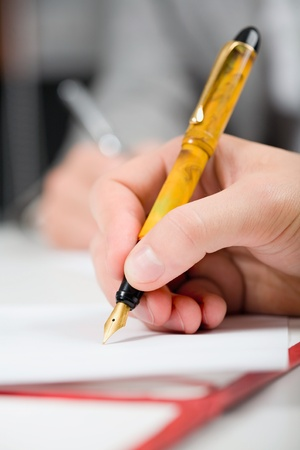 Close up of a hand holding a pen Stock Photo - 8313170
