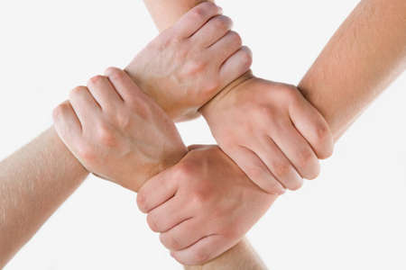 Conceptual image of crossed hands isolated over white background photo