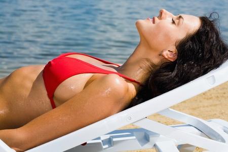 Close-up of half face of woman enjoying by sun  photo