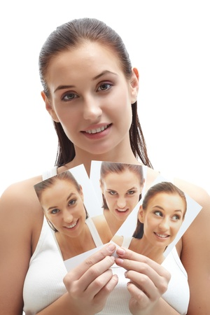 Portrait of pretty female showing three images of herself photo