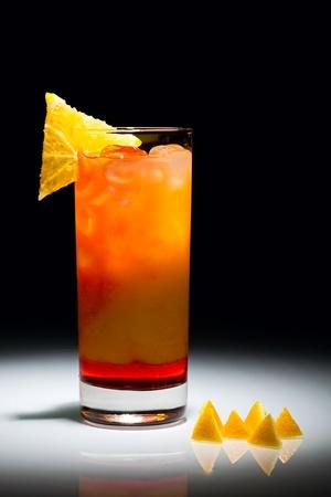 highball: Campari orange cocktail with slice of orange isolated on the black background