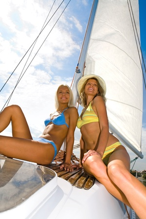Portrait of two attractive women relaxing in cruise photo
