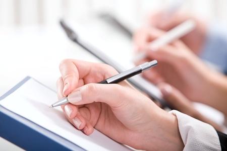 Row of writing human hands photo