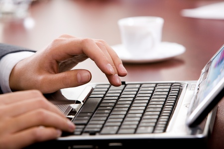 Image of hand preparing to type a letter photo