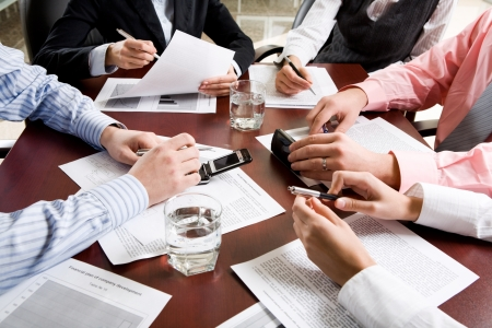 workteam: Image of different hands at business meeting Stock Photo