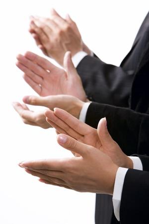 Geïsoleerd op witte rij van klappen van de handen Stockfoto