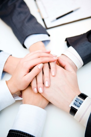 consensus: Conceptual image: different human hands on top of each other  Stock Photo