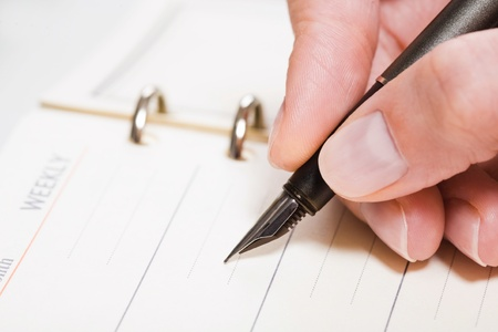 Close-up of a human hand holding the fountain-pen Stock Photo - 8314185