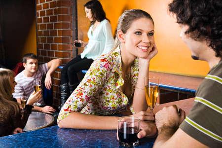 Portrait of pretty woman gazing at her boyfriend in a night club photo