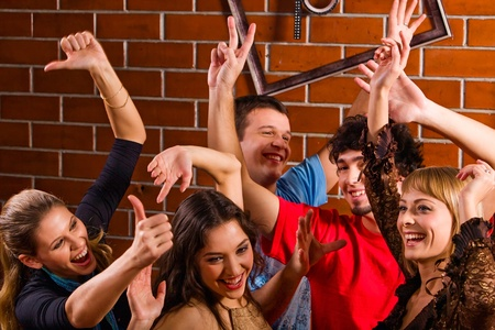 Group of friends dancing at a night club Stock Photo - 8314283