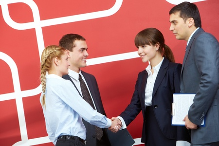 ovation: Image of businesswomen handshaking with two businessmen near by