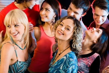 Portrait of happy people interacting at a evening-party Stock Photo - 8357273