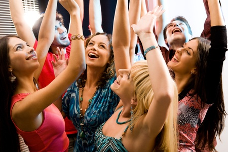 Portrait of laughing people raising their hands Stock Photo - 8357251
