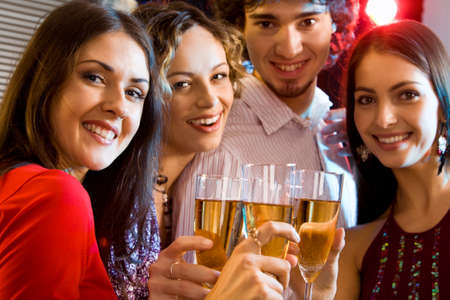 Portrait of students holding the glasses making a toast Stock Photo - 8357210