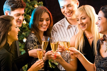 friends party: Image of several attractive friends making a clink of champagne bocals Stock Photo
