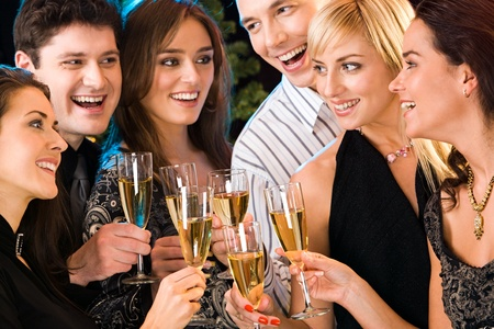 Portrait of six happy people holding glasses of champagne making a toast Stock Photo - 8357274