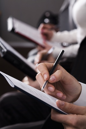 Line of writing hands Stock Photo - 8356608