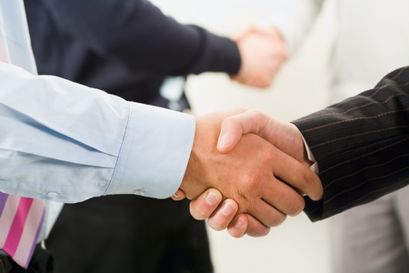 Image of row of business people shaking hands photo