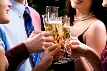 Image of human hands holding the glasses of champagne making a toast  photo