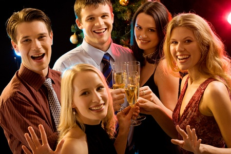 holiday gathering: Image of five young people marking by celebration