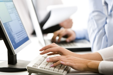 Female hands typing a letter on the keyboard photo