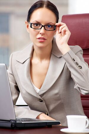 Portrait of a successful businesswoman looking at camera in office Stock Photo - 8356605