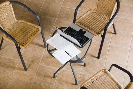 Creative image: three abandoned chairs, table, laptop, papers, pen Stock Photo - 8357313