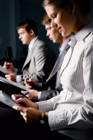 Portrait of business people writing a text at seminar in the evening Stock Photo - 8357336