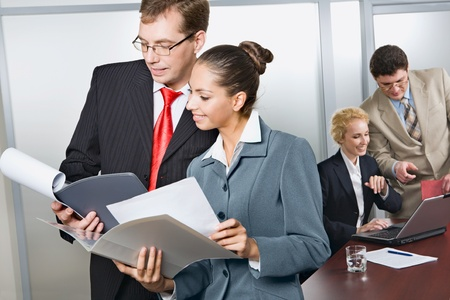 Confident business people are discussing business strategy in the office  photo