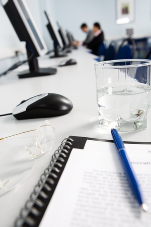 Glass of water, notepad, pen and eyeglasses at workplace Stock Photo - 8357356