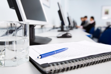 Workplace with notepad and pen Stock Photo - 8357358